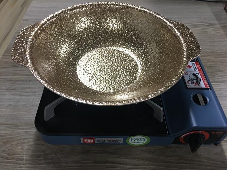 器演黄金锅